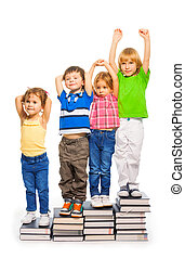 Four kids sitting on the books
