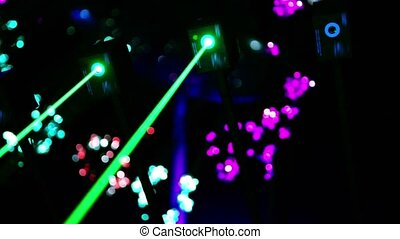 Four lasers hang under ceiling and emit  rays