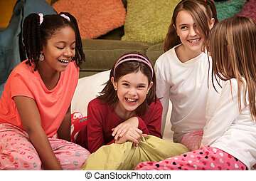 Group of four happy little girls at a sleepover
