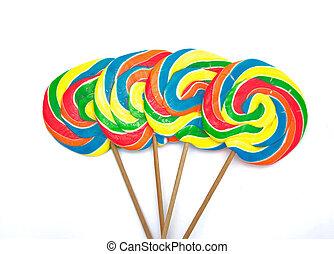 four lollipops on white background