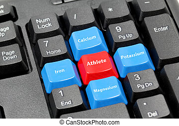 four mineral for athlete on blue, red and black keyboard