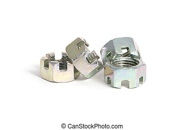 four new steel castellated nuts on a white background