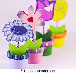 Four painted decorative flowers