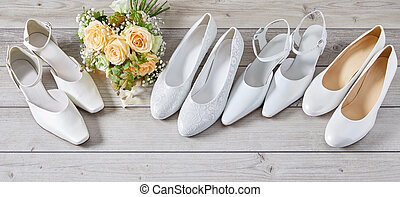 Four pairs of different white wedding shoes