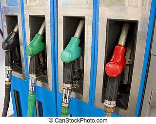 Four petrol pumps, close up