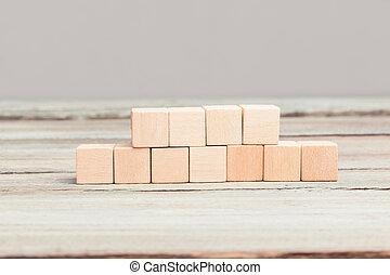 Four plus seven blank wood cubes