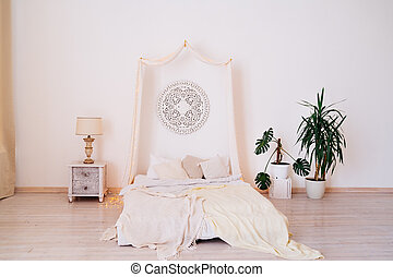 four-poster bed and bright interior. Scandinavian style.