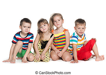 Four preschool children sit on the floor