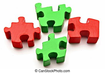Four puzzle pieces red and gree