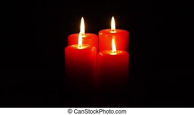 christmas candles burning - four red christmas candles...