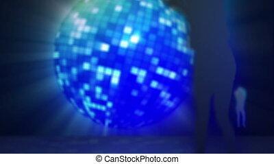 Four screens against a disco ball