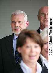 Four senior business people