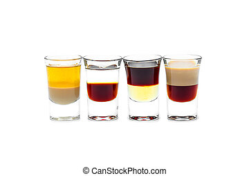 Four short alcoholic drink in a glass on a white background