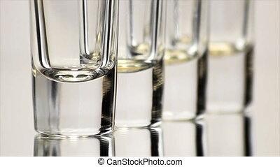 Four Shot Glasses Bottoms - Extreme close up (ECU) of the...