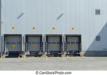 Four shutter doors at a warehouse