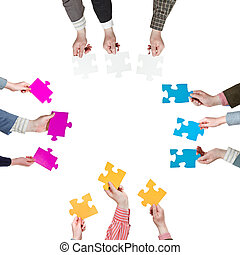 sides with people hands holding puzzle pieces