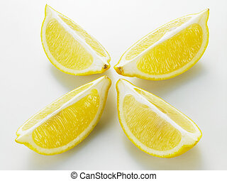 four slices of lemon on the white background