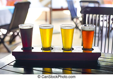 Four sorts of beer. Beer tasting. Ale, porter, lager,...