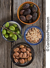 Stages of argan fruits, from fresh to seeds