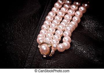 pearls on black leather