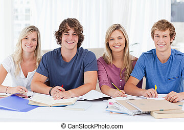 Four students looking at the camera