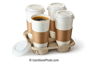 Four take-out coffee in holder. One cup is opened. Isolated ...