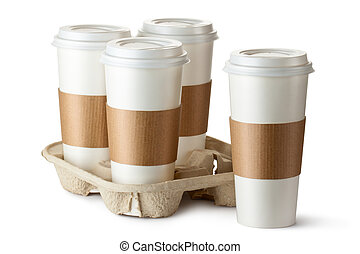 Four take-out coffee. Three cups in holder. Isolated on a ...