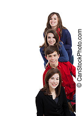 Four teenagers smiling on a white background