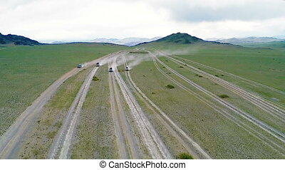Four tourist jeep ride through the desert