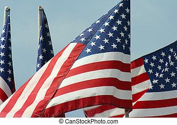four U.S. flags in breeze