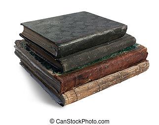 four vintage books.