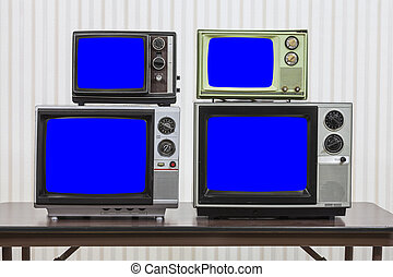 Four Vintage Televisions With Chroma Key Blue Screens