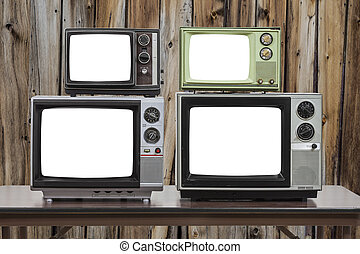 Four Vintage Televisions With Cut Out Screens and Old Wood Wall