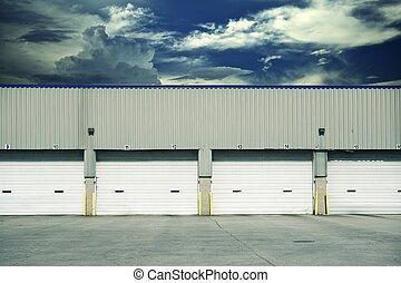 Four Warehouse Gates - Four Warehouse Truck Docks. Business...