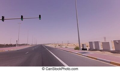 Four-way intersection with traffic lights on the highway in desert stock footage video