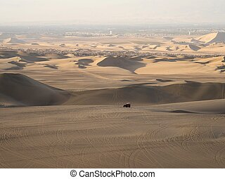 Four wheel drive 4WD 4x4 dune beach buggy motor vehicle tour in sand desert Huacachina Ica Peru South America