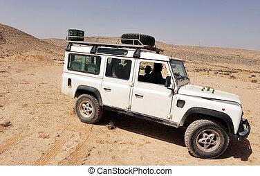 A 4x4 car drive in the desert.