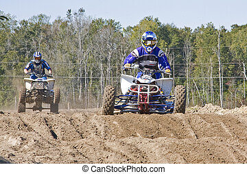 Fast pace motocross race, one man in the lead
