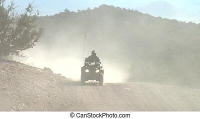 four Wheeler on dusty road