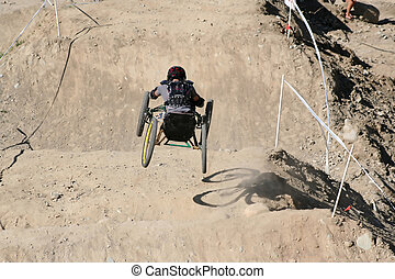 Four Wheels - A paraplegic racer flies down the hill on his...