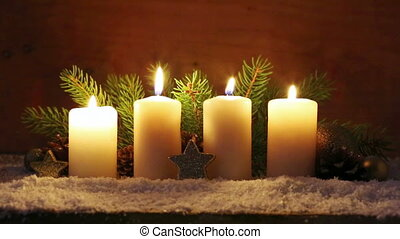 Four white Advent candles with christmas decoration. -...