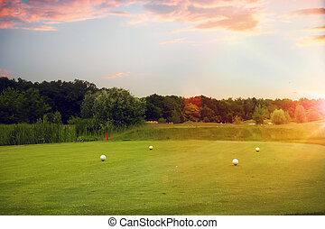 Four white balls on golf course, launching point