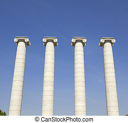 Four white columns near Royal palace. The columns, symbolizing the four stripes of the Catalan flag