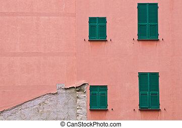 Four window on a broken wall