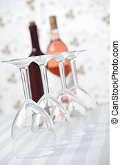 Four Wineglasses and Two Wine Bottles