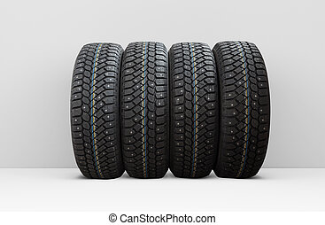 Four winter car tires with snow spikes, isolated