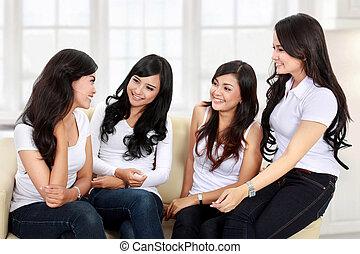 four women friends talking