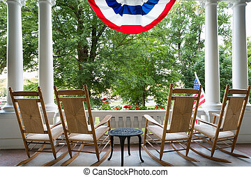 Four wooden rocking chairs and the American flag - Four ...