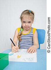 Four-year girl draws pencil drawing