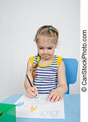 Four-year girl draws pencils